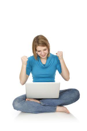 Caucasian teenager woking on laptop computer photo