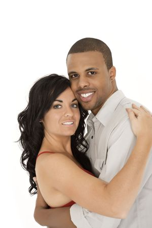Interracial couple sharing and intimate moment photo