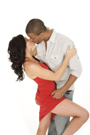 young couple kissing: Interracial couple sharing and intimate moment