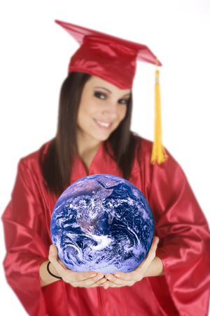Beautiful Caucasian teenager in a graduation gown holding the world photo