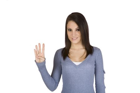Beautiful Caucasian teenager counting on fingers on green background photo
