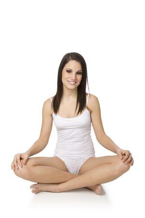 Beautiful Caucasian woman practising yoga on a white background. Stock Photo