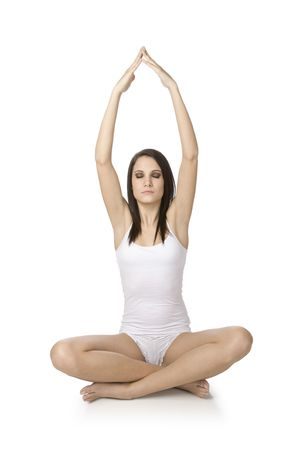 Beautiful Caucasian woman practising yoga on a white background Stock Photo - 4184087