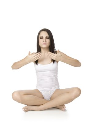 Beautiful Caucasian woman practising yoga on a white background. Stock Photo