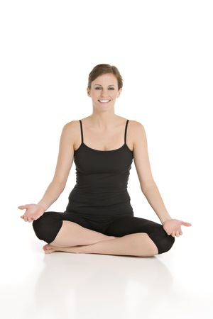Beautiful Caucasian woman practicing yoga on a white background. Stock Photo