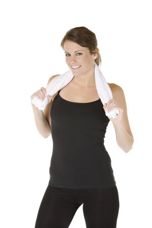 Caucasian woman in fitness outfit holding a towel Stock Photo