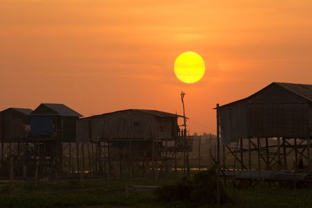 deficiency: Sunset on a rural village in Cambodia