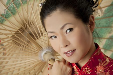 Beautiful Chinese woman in traditional Chinese clothing Stock Photo