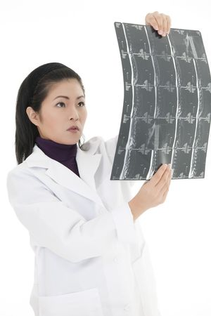 Beautiful Asian doctor reading an mri on a white background photo