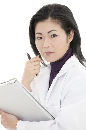 Beautiful Asian woman DoctorNurse working at a desk photo