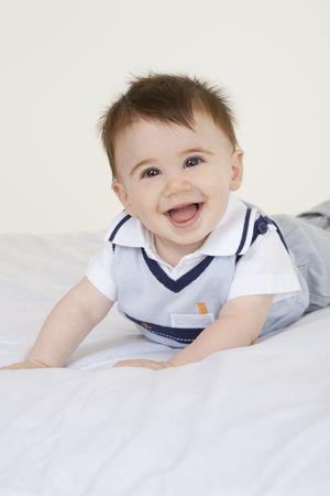 A very cute happy Caucasian baby boy photo