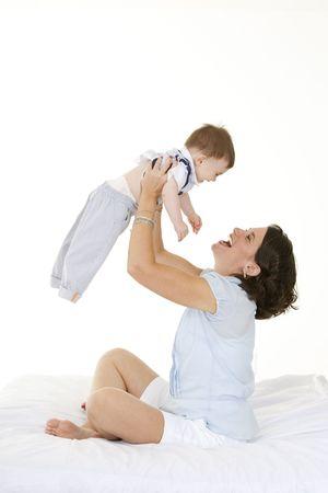 Beautiful Caucasian mother and baby boy  bonding photo