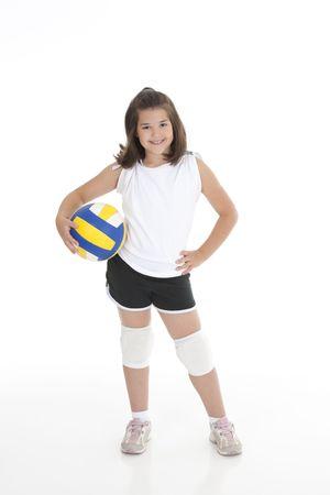 pelota de voley: Retrato de una linda ni�a de ocho a�os en el conjunto de voleibol Foto de archivo