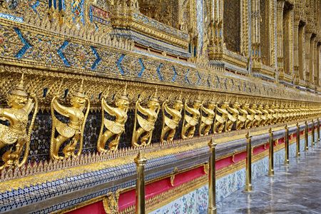 Gold ornamental patter statuettes.  Temple of the Emerald Buddha   The Grand Palace  Bangkok   Thailand photo