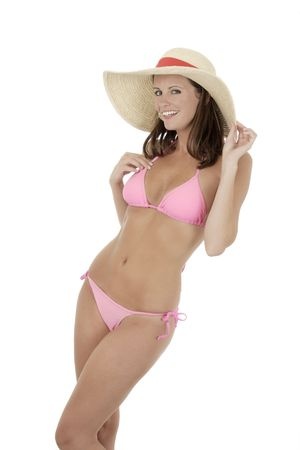 A very sexy Caucasian woman weraing a pink bikini and a hat
