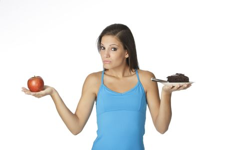 Cute Caucasian woman trying to make a decision between eating healthy or not Stock Photo - 5493983