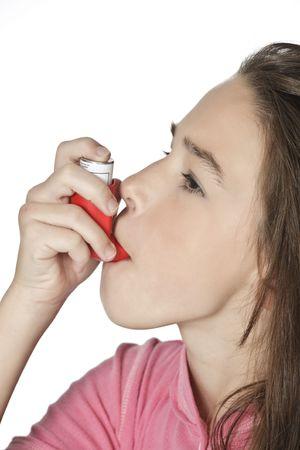 Cute Caucasian girl using an inhaler for Asthma photo