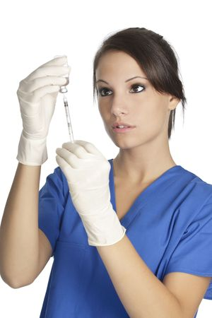 gloves nurse: Beautiful Caucasian doctor  nurse with hypodermic syringe that is being filled with vaccine