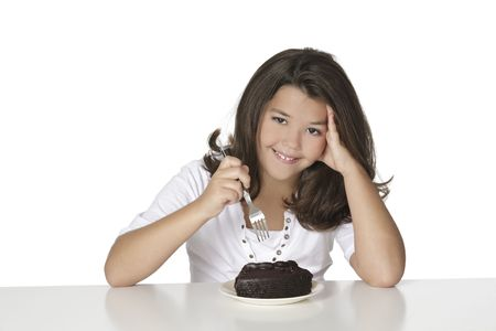 snacking: Cute Caucasian child eating a slice of chocolate cake Stock Photo