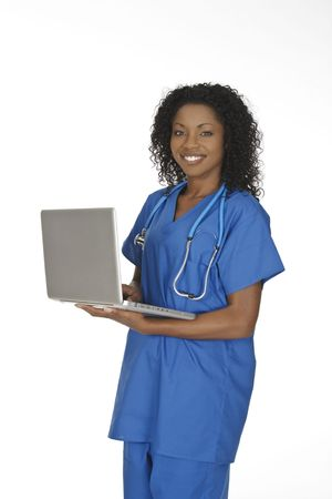 Beautiful African American doctor or nurse holding a laptop computer photo