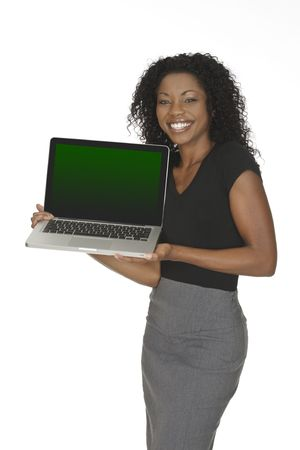 Beautiful African American businesswoman holding and pointing at a laptop computer  photo