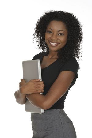 Beautiful African American businesswoman holding a laptop computer photo
