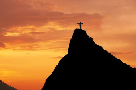 Christ the Redeemer on Corcovado Mountain, Rio de Janeiro  Brazil South America  The statue stands 38 m (125 feet) tall and is located at the peak of the 710-m (2330-foot) Corcovado mountain in the Tijuca Forest National Park, overlooking the city. As wel Stock Photo - 5782161
