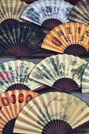 color fan: Beautiful handmade paper fans on dispaly in the village of Fuli  Fuli is famous for the making of paper fans  Guangxi Autonomous Region, China Stock Photo