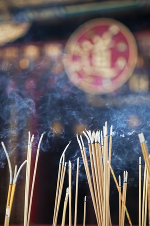worshipers: Incense left burning  by worshipers at Wong Tai Sin Temple  Also known as Sik Sik Yuen Wong Tai Sin Temple, is a Taoist Temple is located in Kowloon, Hong Kong, China Stock Photo