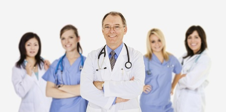 Successful young doctors smiling over a white background photo