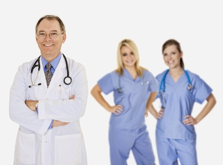 Successful doctors smiling over a white background photo