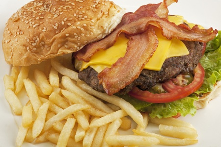 cheeseburger with fries: A delicious cheese burger with bacon and french fries