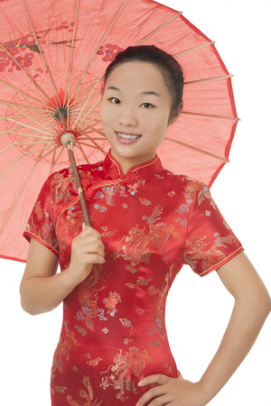traditional culture: Beautiful Chinese woman wearing a traditional dress known as a Chipao isolated on a white background