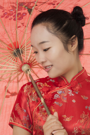 tradition: Beautiful Chinese woman wearing a traditional dress known as a Chipao