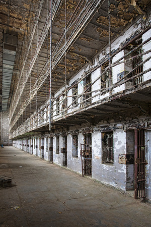 incarcerate: Cell block of the inside of an old prison no longer in use