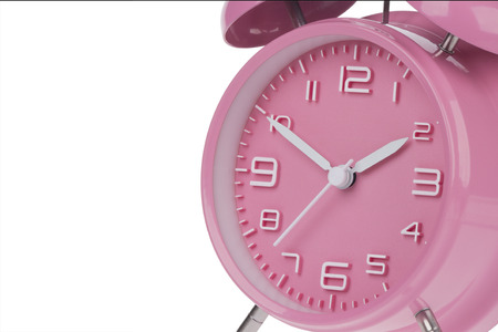 pm: Pink alarm clock with the hands at 10 and 2 am or pm isolated on a white background