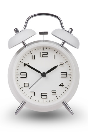 pm: White alarm clock with the hands at 10 and 2 am or pm isolated on a white background