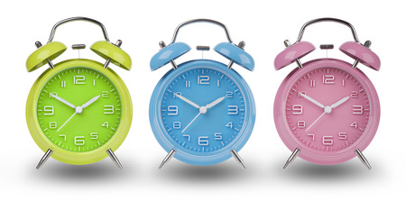 pm: Three alarm clocks with the hands at 10 and 2 am or pm isolated on a white background