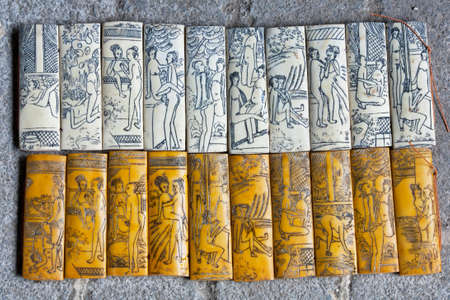 sutra: A souvenir bamboo carving showing the different kamasutra positions