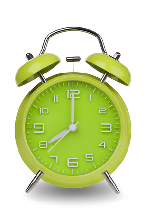 pm: Green alarm clock with the hands at 8 am or pm isolated on a white background with a clipping path. One of a set of 12 images showing the top of the hour starting with 1 am  pm and going through all 12 hours