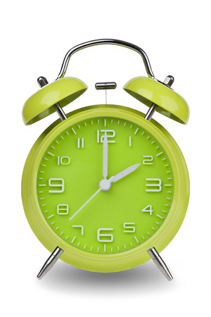 pm: Green alarm clock with the hands at 2 am or pm isolated on a white background. One of a set of 12 images showing the top of the hour starting with 1 am  pm and going through all 12 hours