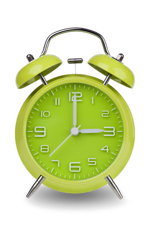 12 hour: Green alarm clock with the hands at 3 am or pm isolated on a white background. One of a set of 12 images showing the top of the hour starting with 1 am  pm and going through all 12 hours