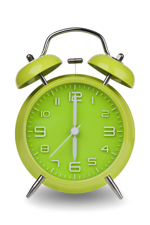 12 hour: Green alarm clock with the hands at 6 am or pm isolated on a white background. One of a set of 12 images showing the top of the hour starting with 1 am  pm and going through all 12 hours