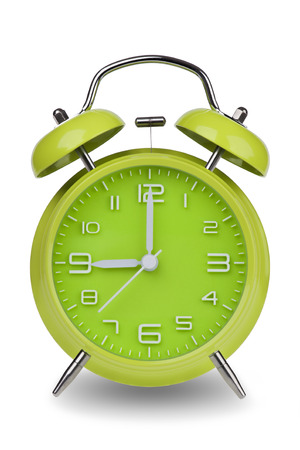 12 hour: Green alarm clock with the hands at 9 am or pm isolated on a white background with a clipping path. One of a set of 12 images showing the top of the hour starting with 1 am  pm and going through all 12 hours