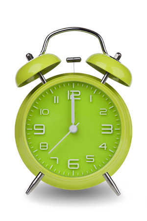 morning noon and night: Green alarm clock with the hands at 12 am or pm isolated on a white background. One of a set of 12 images showing the top of the hour starting with 1 am  pm and going through all 12 hours