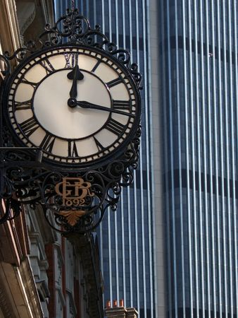 to chime: Old and New - an old 19c clock face against a modern tower block - this one in London