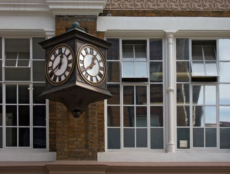 two faced: old two faced clock on an old building Stock Photo