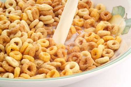 arise: Bowl of breakfast cereal with fresh milk being poured