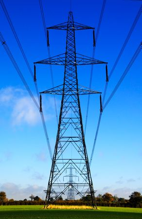 deface: Electrical sentries - electricity pylons in the English countryside Stock Photo