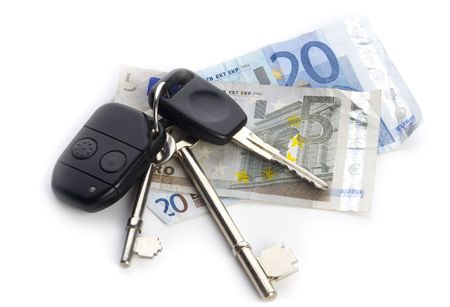 clicker: Cash and Keys, old house and car keys with infra red clicker on Euro notes